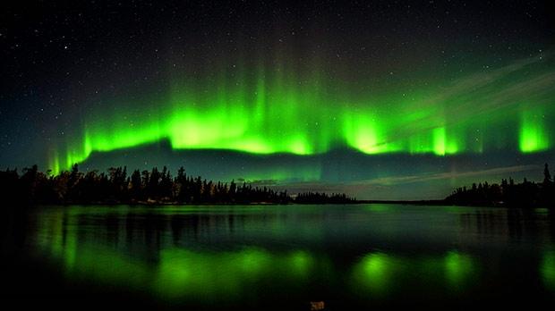 Northern Lights over Knee Lake. Photo by Wayne Boychuk.