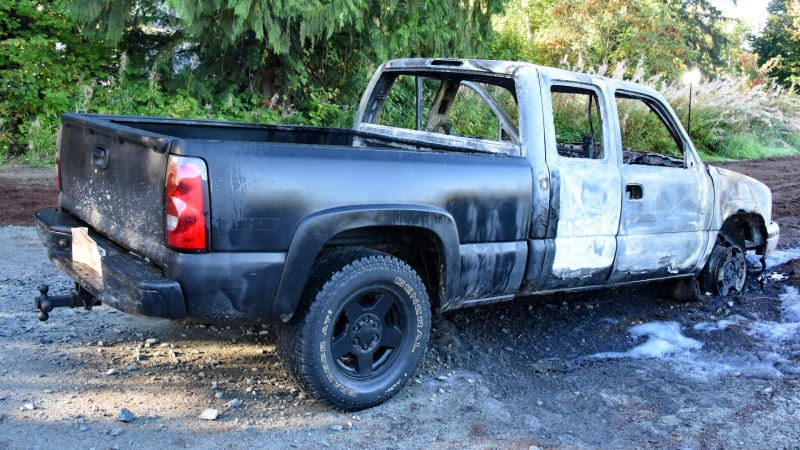 A burned out Chevrolet Silverado is seen following an early fire in Maple Ridge, B.C., on Sept. 25, 2021. A body was found inside the wreckage after the flames were put out.