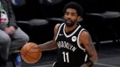 Brooklyn Nets guard Kyrie Irving handles the ball during an NBA basketball game against the Dallas Mavericks in Dallas, in this Thursday, May 6, 2021, file photo. (AP Photo/Tony Gutierrez)