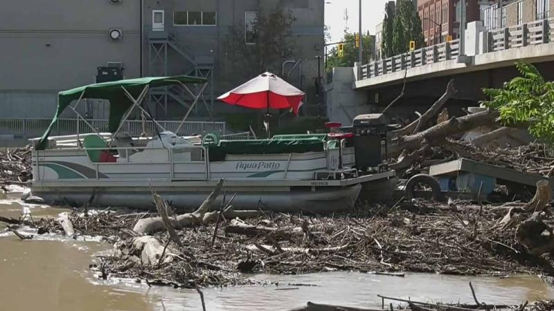 Flood debris washes down Thames River