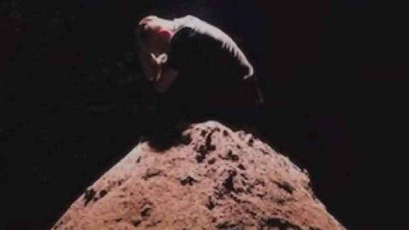 Artist shoveling tons of sand at Olympic Stadium