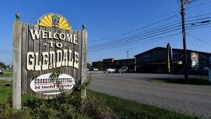 A sign welcomes visitors to the tiny town of Glendale, Ky., the site of a joint venture with Ford Motor Company and SK Innovation to create the $5.8 billion BlueOvalSK Battery Park in Glendale, Ky., Monday, Sept. 27, 2021. (AP Photo/Timothy D. Easley)