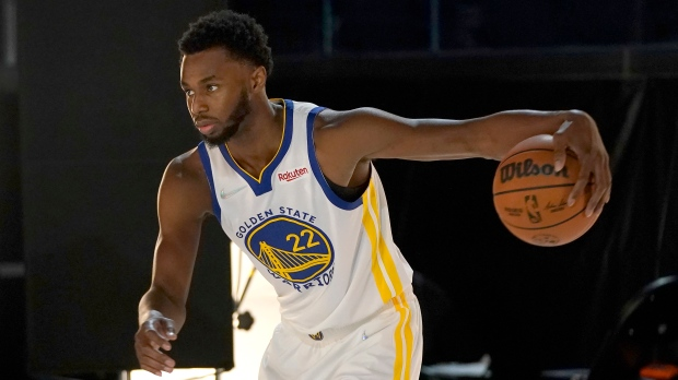 Golden State Warriors forward Andrew Wiggins poses for photos during the team's media day in San Francisco, Sept. 27, 2021. (AP Photo/Jeff Chiu)