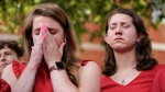Summerleigh Geimer, left, and her sister Montana Geimer, daughters of Wendi Winters, a community beat reporter who died in the Capital Gazette newsroom shooting, react during a press conference following a verdict in the trial of Jarrod W. Ramos, Thursday, July 15, 2021, in Annapolis, Md. (AP Photo/Julio Cortez)