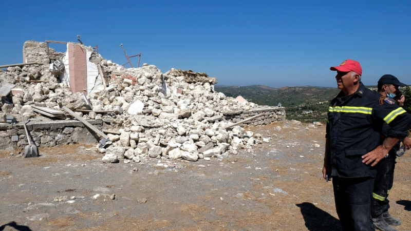 Firefighters stand next to a demolished Greek Orthodox church of Profitis Ilias after a strong earthquake in Arkalochori village on the southern island of Crete, Greece, Monday, Sept. 27, 2021. (AP Photo/Harry Nikos)