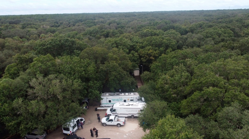Law enforcement officials conduct a search of the vast Carlton Reserve in the Sarasota, Florida, area for Brian Laundrie on Saturday, September 18.