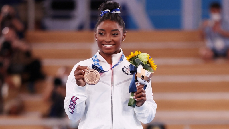 Biles poses with the bronze medal at Ariake Gymnastics Centre, Tokyo. (Jamie Squire/Getty Images)