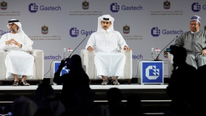 From left, Emirati Energy and Infrastructure Minister Suhail al-Mazrouei, Qatar's Minister of State for Energy Affairs Saad Sherida al-Kaabi and OPEC Secretary-General Mohammad Sanusi Barkindo sit on stage during the Gastech 2021 conference in Dubai, United Arab Emirates, Tuesday, Sept. 21, 2021. (AP Photo/Jon Gambrell)
