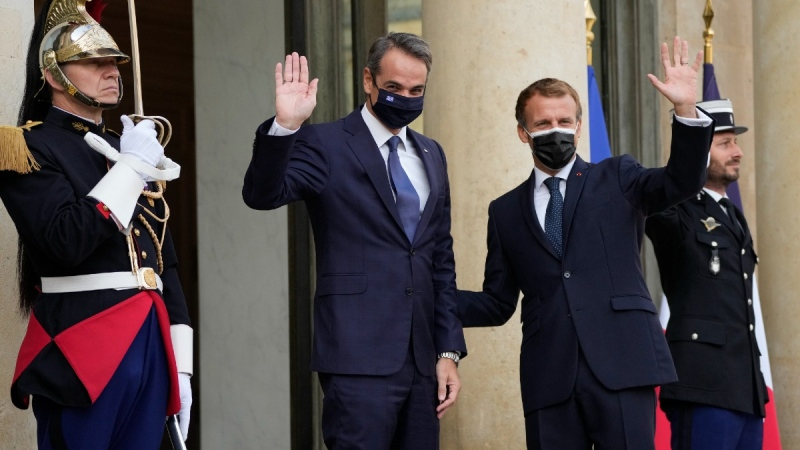 French President Emmanuel Macron and Prime Minister Kyriakos Mitsotakis at the Elysee Palace in Paris, on Sept. 28, 2021. (Francois Mori / AP)