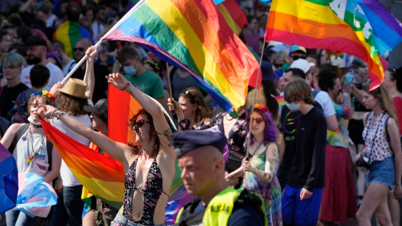 People take part in the Equality Parade, the largest gay pride parade in central and eastern Europe, in Warsaw, Poland, Saturday June 19, 2021. (AP Photo/Czarek Sokolowski)
