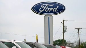 A Ford logo is seen on signage at Country Ford in Graham, N.C., Tuesday, July 27, 2021. (AP Photo/Gerry Broome)
