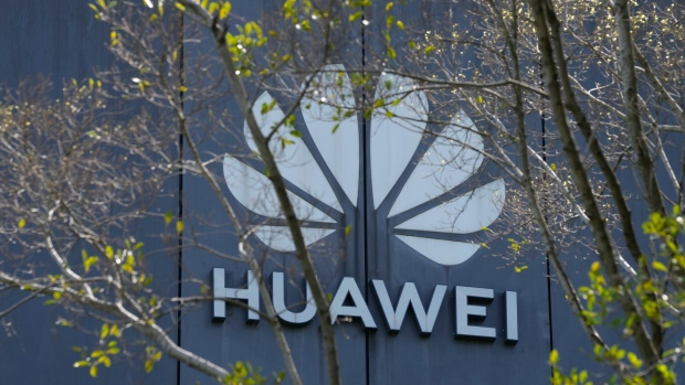 The Huawei brand logo is seen on a building in the sprawling Huawei headquarters campus in Shenzhen, China, Saturday, Sept. 25, 2021. (AP Photo/Ng Han Guan)