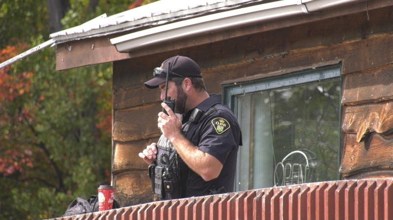 OPP constable at search and rescue post set up at Lake Onaping Lodge after two hunters went missing. Sept. 28/21 (Molly Frommer/CTV Northern Ontario)