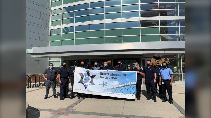 Federal correctional officers from Stony Mountain Institution pose outside Canadian Blood Services in Winnipeg at the kick-off of their blood drive. (Source: Jamie Dowsett)