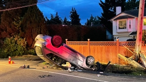 A grey Mazda hatchback was travelling westbound when it crashed into a culvert, flipped into the air and struck a utility pole, coming to rest on its roof. (RCMP)