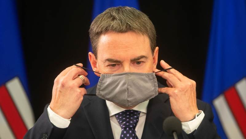 New Alberta Health Minister Jason Copping takes his mask off to give a COVID-19 update in Edmonton, Tuesday, Sept. 21, 2021. THE CANADIAN PRESS/Jason Franson