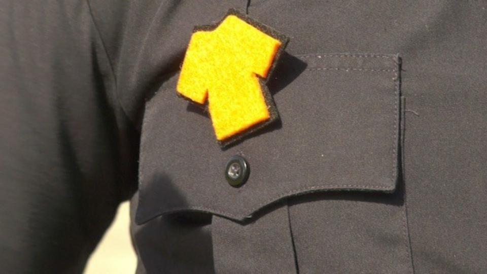 Orange shirt pin