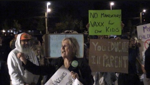 Anti-vax protesters gather outside Louise Arbour French Immersion Public School where a TVDSB meeting was being held, Sept. 29, 2021. (Daryl Newcombe / CTV News)
