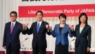In this Sept. 17, 2021, file photo, candidates for the presidential election of the ruling Liberal Democratic Party pose prior to a joint news conference at the party's headquarters in Tokyo. (Kimimasa Mayama/Pool Photo via AP)