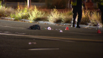 Personal items and evidence markers on 50 Avenue during the investigation into an early morning hit-and-run near Macleod Trail.