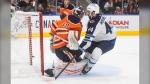 Winnipeg Jets' Josh Morrissey (44) scores on Edmonton Oilers goalie Mikko Koskinen (19) during third period NHL preseason action in Edmonton on Saturday, October 2, 2021. (THE CANADIAN PRESS/Jason Franson)