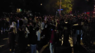 Hundreds of people take over a Sandy Hill street to celebrate following the Panda Game in Ottawa. (Aaron Reid/CTV News Ottawa)