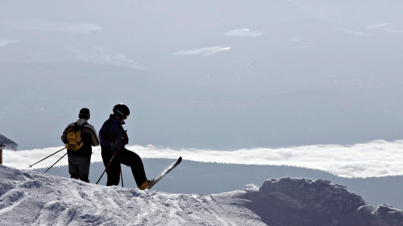 FILE - Skiers stand at the top of Big White ski resort Feb. 2, 2005 near Kelowna, B.C. THE CANADIAN PRESS/Jacques Boissinot