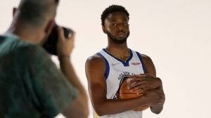 Golden State Warriors forward Andrew Wiggins poses for photographs during the team's media day in San Francisco, Sept. 27, 2021. (AP Photo/Jeff Chiu)