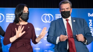 Montreal mayoral candidates Denis Coderre and Valerie Plante keep their distance as they pose for photos after their debate, Wednesday, September 29, 2021 in Montreal.THE CANADIAN PRESS/Ryan Remiorz