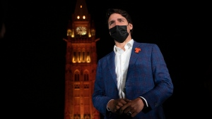 The Peace Tower glows orange as Canadian Prime Minister Justin Trudeau participates in a ceremony on Parliament Hill on the eve of the first National Day of Truth and Reconciliation, Wednesday, September 29, 2021 in Ottawa. THE CANADIAN PRESS/Adrian Wyld