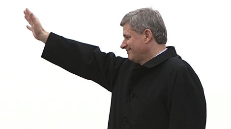Prime Minister Stephen Harper waves as he leaves Ottawa, Ont. to attend the Commonwealth Heads of Government Meeting in Port of Spain, Trinidad and Tobago, Thursday, Nov. 26, 2009. (Sean Kilpatrick / THE CANADIAN PRESS)