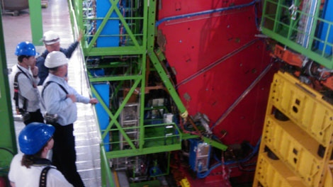 Jeff Joyce and his colleague, Laurent Fabre, along with two CERN engineers are pictured inspecting the Compact Muon Solenoid detector (part of the Large Hadron Collider apparatus) at a near Geneva, about 100 metres below the ground. (Courtesy of Jeff Joyce)