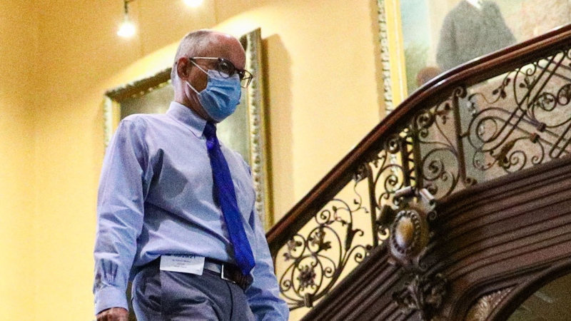 Dr. Kieran Moore, Ontario's chief medical officer of health walks through Queen's Park before a press conference regarding COVID-19 at the Ontario Legislature in Toronto on Wednesday, September 29, 2021. THE CANADIAN PRESS/Evan Buhler