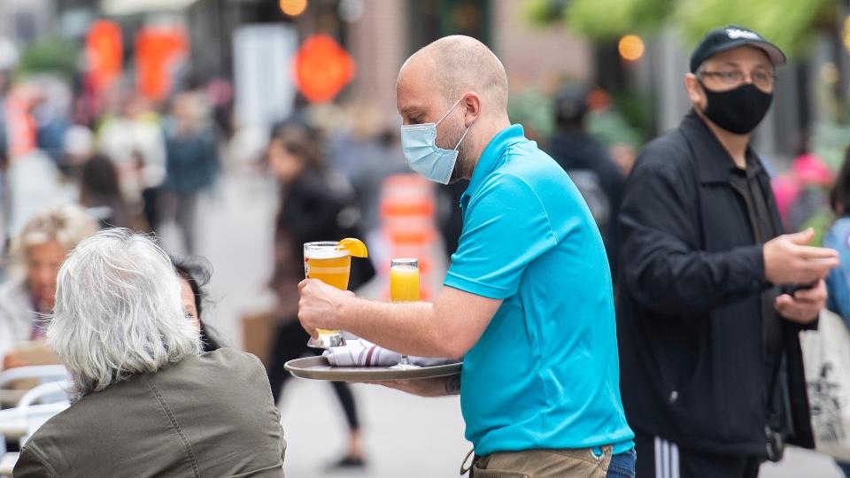 A server wears a face mask