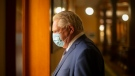 Ontario Premier Doug Ford walks to his office in the Queen's Park Legislature in Toronto on Monday, June 14, 2021. THE CANADIAN PRESS/Chris Young