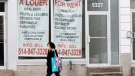 A pedestrian walks past a vacant storefront as the COVID-19 pandemic continues to impact small businesses Monday, November 23, 2020 in Montreal.THE CANADIAN PRESS/Ryan Remiorz