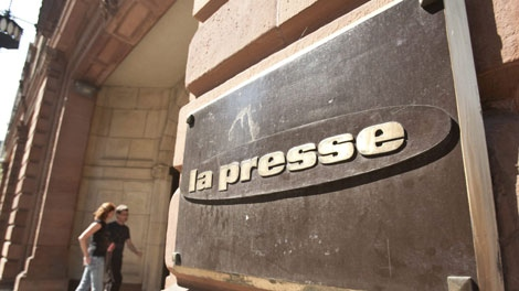 Employees enter the La Presse offices Thursday, September 3, 2009 in Montreal. Montreal's La Presse newspaper, the biggest French-language broadsheet in North America, is threatening to cease publication on Dec. 1. (THE CANADIAN PRESS/Paul Chiasson)