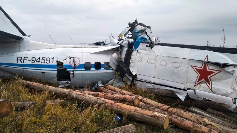 This photo provided by the Russian Emergency Situations Ministry press service shows the L-410, a Czech-made twin-engine turboprop, crashed near the town of Menzelinsk, about 960 kilometers (600 miles) east of Moscow, Russia, Sunday, Oct. 10, 2021. (Ministry of Emergency Situations press service via AP)