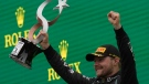 Mercedes driver Valtteri Bottas of Finland holds the trophy on the podium after winning the Turkish Formula One Grand Prix at the Intercity Istanbul Park circuit in Istanbul, Turkey, Sunday, Oct. 10, 2021. (AP Photo/Francisco Seco)