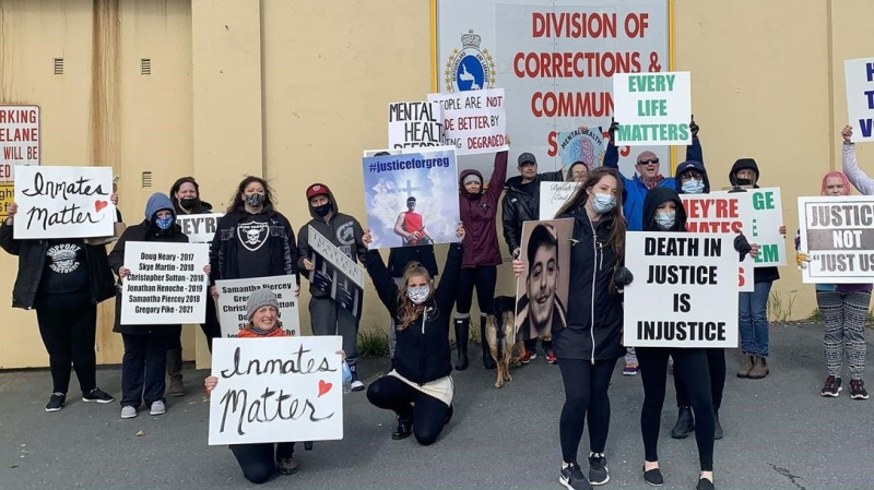 A few dozen people gathered outside Her Majesty's Penitentiary jail to demand better mental health care for inmates in Newfoundland and Labrador, in St. John's, Saturday, Oct. 9, 2021.  SARAH SMELLIE / THE CANADIAN PRESS