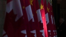 A Chinese flag is illuminated by sunshine in the Hall of Honour as Chinese Premier Li Keqiang visits Parliament Hill in Ottawa, Thursday September 22, 2016. THE CANADIAN PRESS/Adrian Wyld