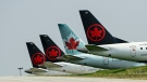 Grounded Air Canada planes sit on the tarmac at Pearson International Airport during the COVID-19 pandemic in Toronto on April 28, 2021. (Nathan Denette / THE CANADIAN PRESS)