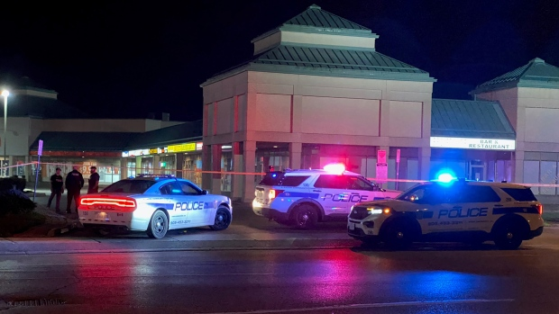 Police are seen in a plaza in Brampton after a fatal shooting on Oct. 12, 2021. (Mike Nguyen/CP24)