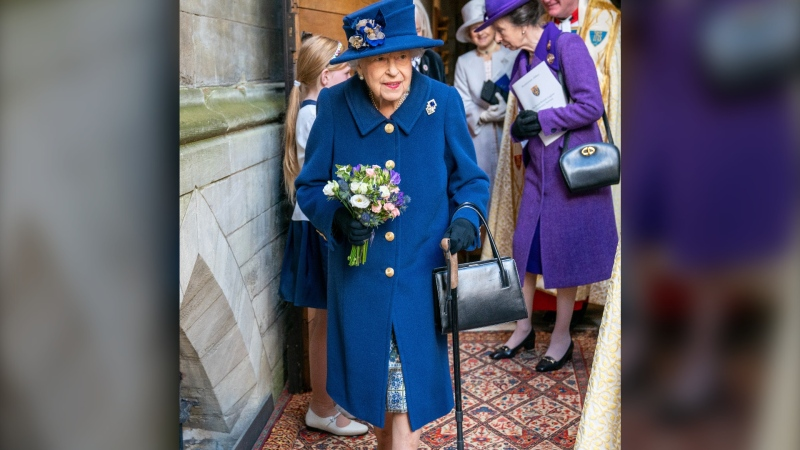 Queen Elizabeth II, followed by Britain's Princess Anne, right, arrives to attend a Service of Thanksgiving to mark the Centenary of the Royal British Legion at Westminster Abbey, in London, Tuesday, Oct. 12, 2021. (Arthur Edwards/Pool Photo via AP)