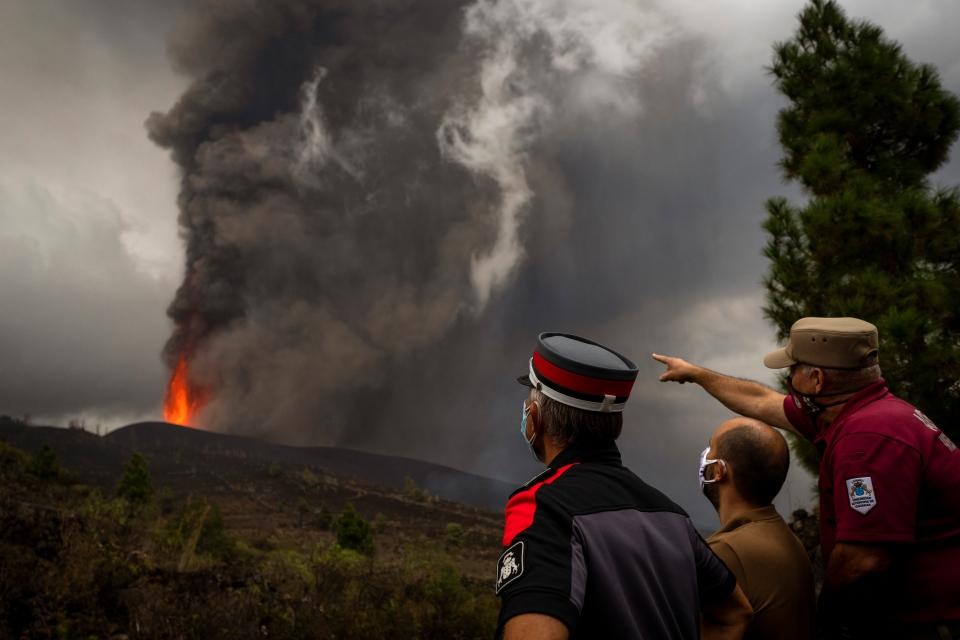 Police officers look at La Palma volcano
