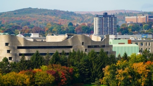 The fall colours of Gatineau Park can be seen on the hills in the background on Tuesday, Oct. 12, 2021.  (Sean Kilpatrick/THE CANADIAN PRESS)