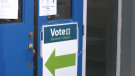 An Elections Calgary sign is seen at a voting station.