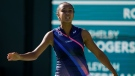 Leylah Fernandez, of Canada, reacts after losing a point to Shelby Rogers at the BNP Paribas Open tennis tournament Tuesday, Oct. 12, 2021, in Indian Wells, Calif. (AP Photo/Mark J. Terrill)