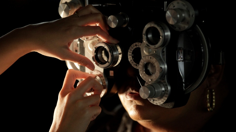 In this April 28, 2010, file photo, an eye exam is performed on a patient at a Remote Area Medical (RAM) clinic inside the Los Angeles Sports Arena in Los Angeles. (AP Photo/Damian Dovarganes, File)