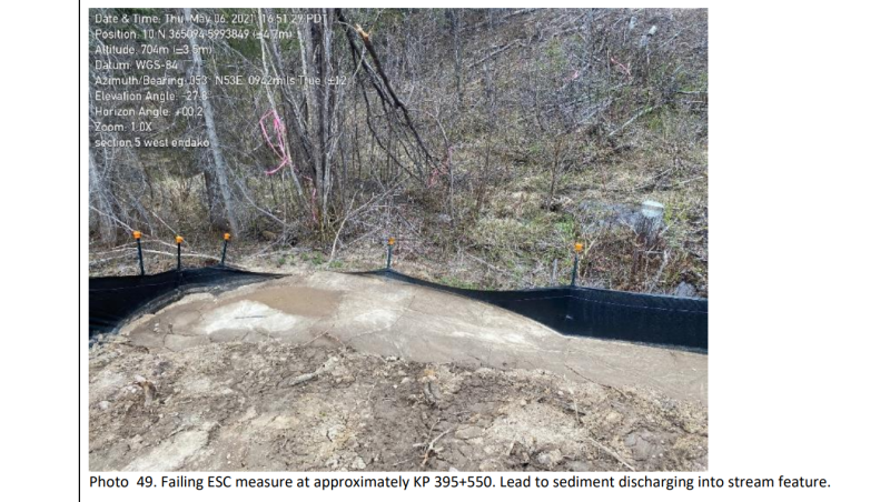 A picture from the BC Environmental Assessment Office's inspection report shows one of Coastal Gaslink's erosion and sediment control measures unsuccessfully holding back sediment, which is discharging into a stream feature. (Photo source: B.C. Environmental Assessment Office).